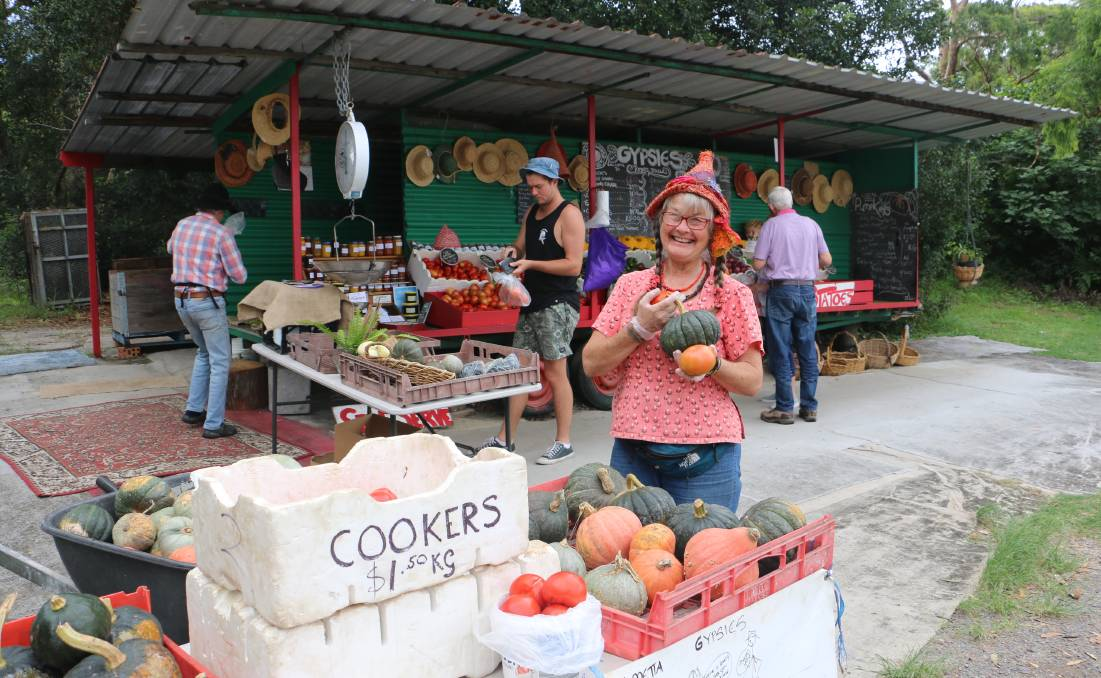 FRESH PRODUCE: Metta Henderson displaying some of the vegetables on offer at the Gypsies trailer off Nelson Bay Road at Anna Bay.