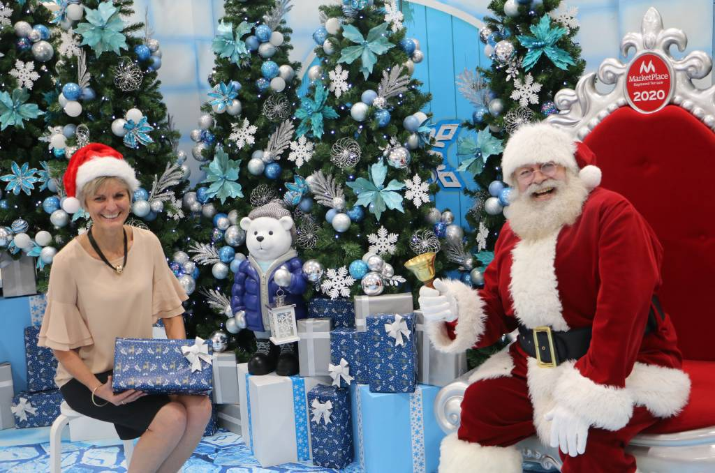 HO HO HO: Practising the 1.5m distance rule are Marketplace centre manager Colleen Mulholland-Ruiz with Santa at the Christmas photography display.