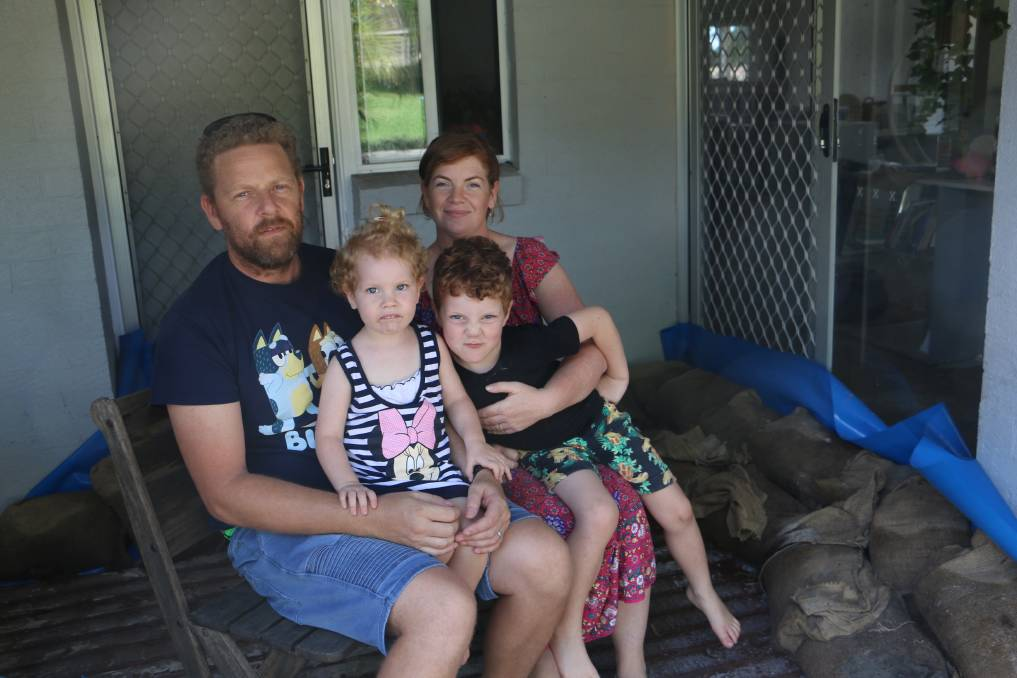 LOCKED OUT: Mal and Chantelle Smith, with children Skyler, aged two, and five-year-old Jasper, wait for insurers to assess the water damage to their home.