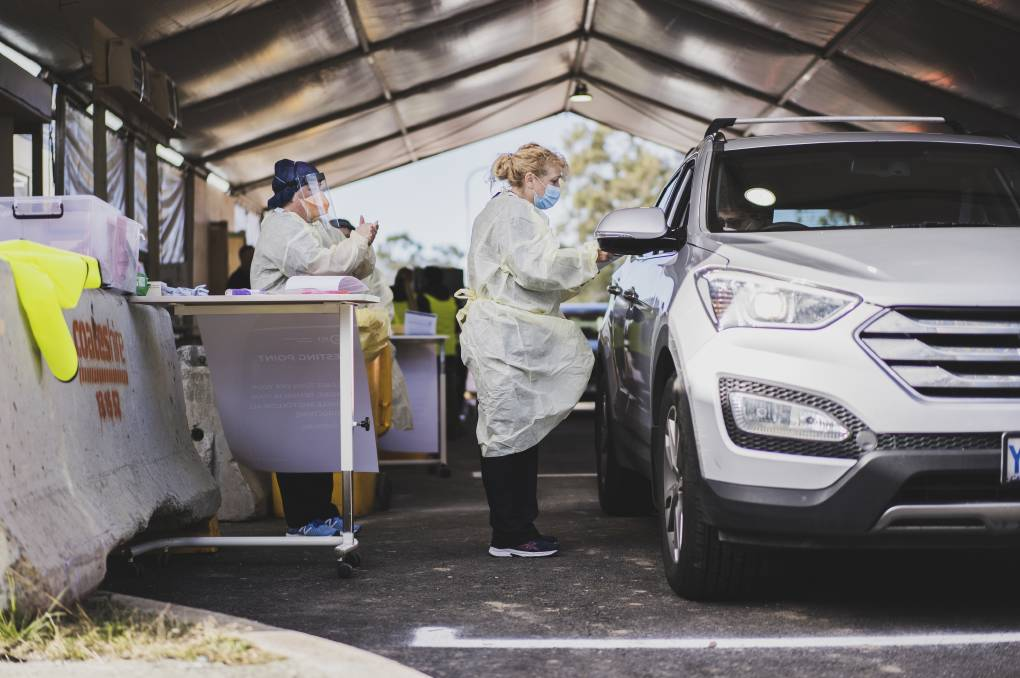 Nurse Di Allende conducts a COVID-19 test at the drive-in COVID-19 testing site in Kambah. Picture: Dion Georgopoulos