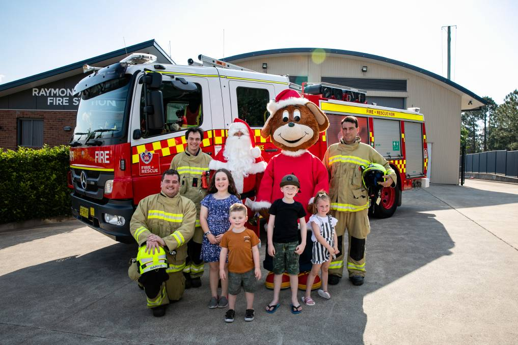 Santa, Raymond Terrace Fire and Rescue and some very excited local children are all set for a fun packed day at Marketplace Raymond Terrace.Photo: Angel Hardy Photography.