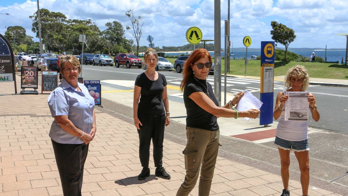 PETITION: Shoal Bay business owner Helen Love (front) with workers and residents opposed to the parklets (from left) Julie, Yasmaheena and Esther.