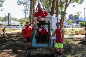 TEAM: Jarad Ashpole (right) with his Ashpole Concrete and Constructions crew in Lions Park on Friday. The crew have been heavily involved in the Medowie 7-Day Makeover. Picture: Ellie-Marie Watts