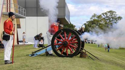 FIRE: The 40th Regiment of Foot, based in Sydney, firing a cannon on the Raymond Terrace riverfront on Saturday for the Step Back Into King Street Heritage Festival. Pictures: Ellie-Marie Watts