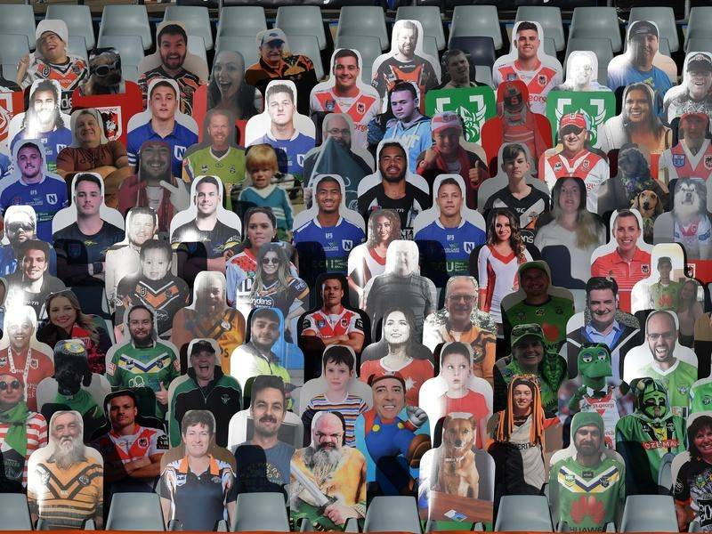 Cardboard cutouts of fans during an NRL round three match.